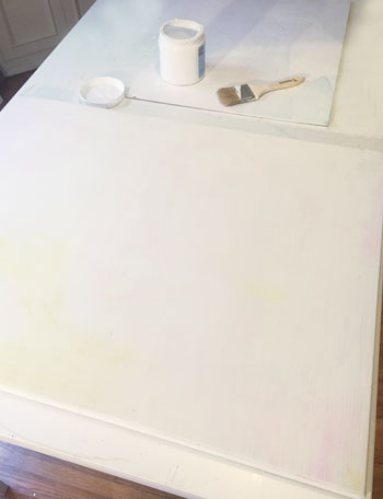 First coat of gesso on a canvas