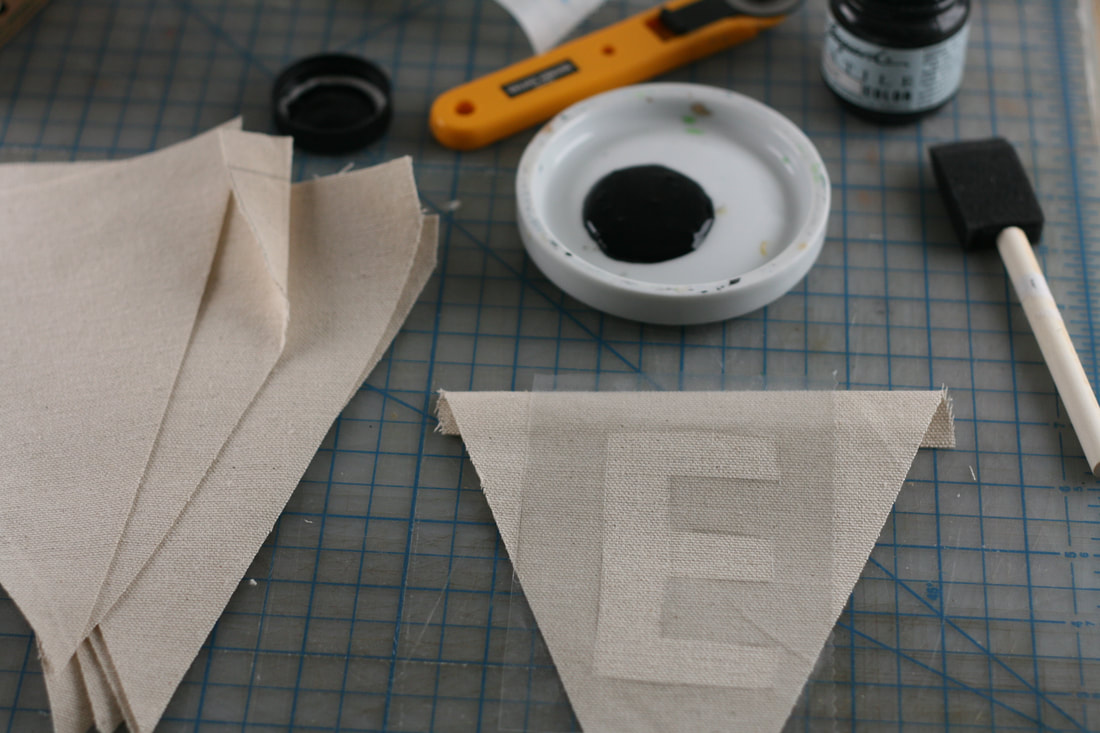 Cutting out triangle pendants for banner